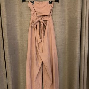 Nude color jump suit in size M.